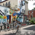 Bixi bikes against a beautifully muraled wall in Montreal
